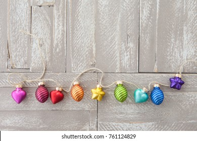 Cheerful christmas decorations on a rustic wooden background