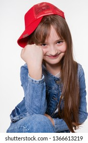 Cheerful clockwork little girl, looking at the camera, threatens with a fist