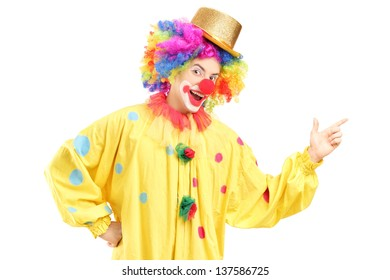 A cheerful clown in a yellow costume isolated on white background