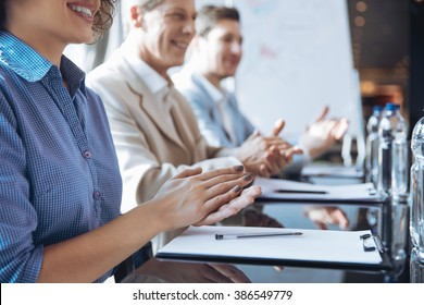Cheerful colleague clapping their hands