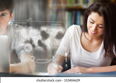 Cheerful college student analysing map on digital interface in university library