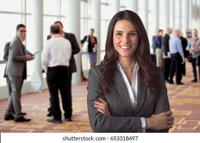 Cheerful corporate employee attending a leadership business seminar in a conference room