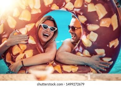 Cheerful couple having fun in the water.