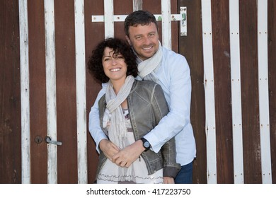 Cheerful couple, man holding the woman tenderly
