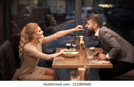 cheerful couple in a restaurant. holiday celebration and party. holiday celebration of young couple in love.