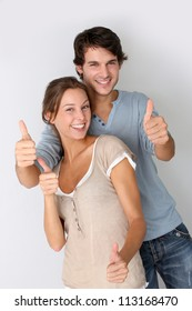 Cheerful couple showing thumbs up, isolated