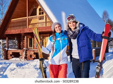 Cheerful couple spend winter holidays at mountain cottage.