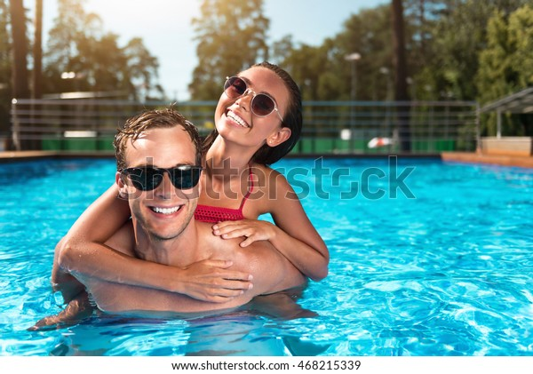 Cheerful couple swimming in a pool