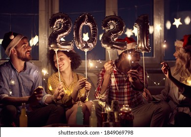 Cheerful couples having good time together at New Year eve home party in festive atmosphere. New Year, home party, friends time together - Shutterstock ID 1849069798