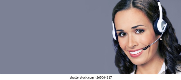 Cheerful customer support phone female operator in headset, with blank copyspace area for text or slogan, over violet background