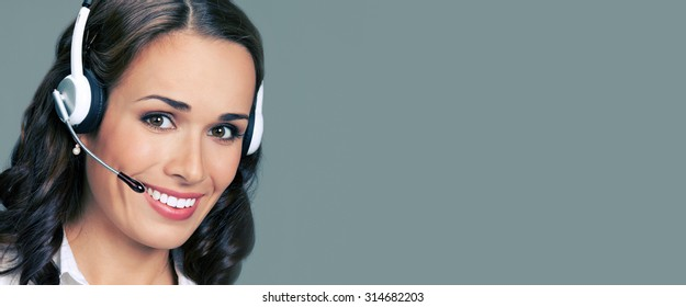Cheerful customer support phone female operator in headset, with blank copyspace area for text or slogan