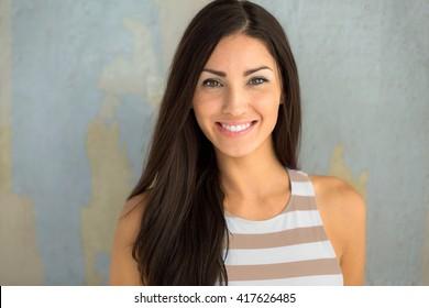Cheerful cute adorable girl next door head shot smiling with perfect white teeth dental head shot