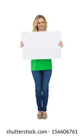 Cheerful cute blonde holding white sign on white background