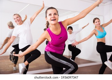 Cheerful different ages women learning swing steps at dance class. High quality photo