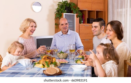 Cheerful dinner in the bosom of family indoor