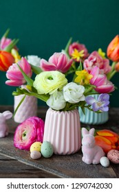 Cheerful easter decorations with fresh spring flowers