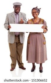 cheerful elderly african couple holding blank banner giving thumbs up
