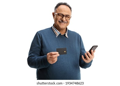 Cheerful elderly man with a credit card and a mobile phone smiling at camera isolated on white background