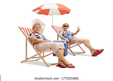 Cheerful elderly man and woman sitting on deckchairs and showing thumbs up isolated on white background