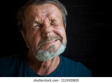 Cheerful elderly mustachioed man close-up portrait