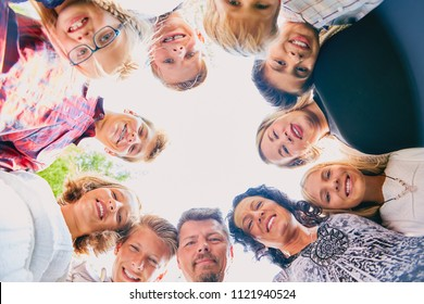 Cheerful eleven people standing in circle