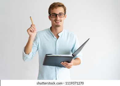 Cheerful enterprising financial advisor with beard raising pen while having idea. Jolly optimistic forecasting manager holding folder with document. Expertise concept