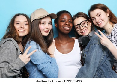 Cheerful European, Asian and African womens.