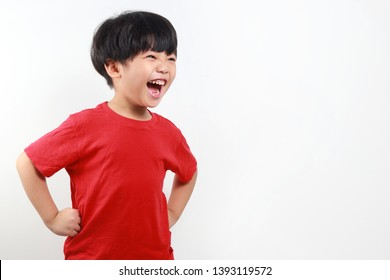 Cheerful and excited asian boy screaming on white background