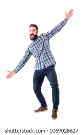 Cheerful excited bearded business man with open arms welcoming hugging gesture. Full body isolated on white background.