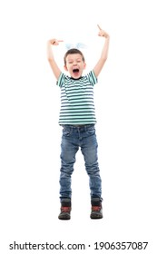 Cheerful excited young kid with Easter bunny ears pointing up and screaming. Full length isolated on white background.