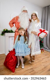 Cheerful family celebrating Christmas. Russian traditions. Father Frost and maiden Snow.