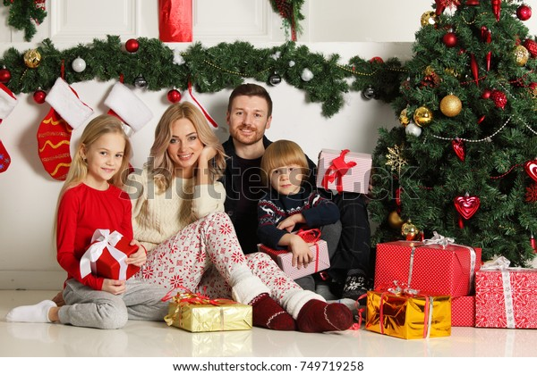 Family Christmas Gifts.Cheerful Family Christmas Gifts Sitting Near Stock Photo