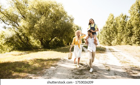 Cheerful Family Going On Picnic On Sumer Day After City Reopening Having Fun Together In Countryside. Panorama, Copy Space