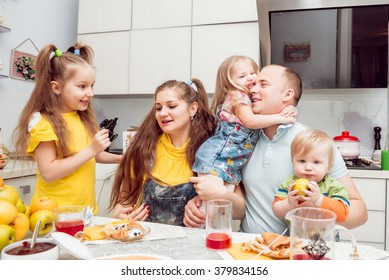 Cheerful family having lunch in the kitchen
