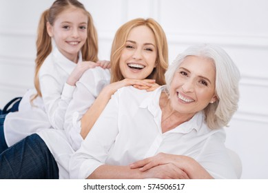 Cheerful family members sitting on the couch