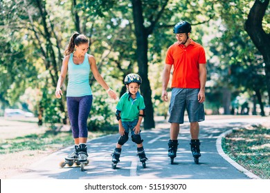 Cheerful family roller skating in park