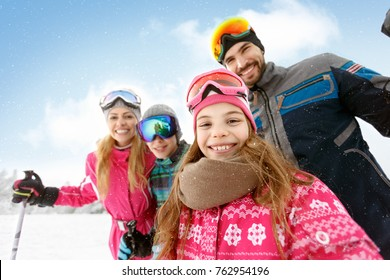 Cheerful family together on skiing