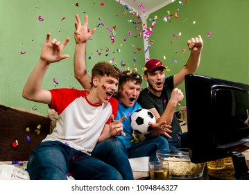 Cheerful family watching soccer cup on television, confetti in the air, success, winning concept