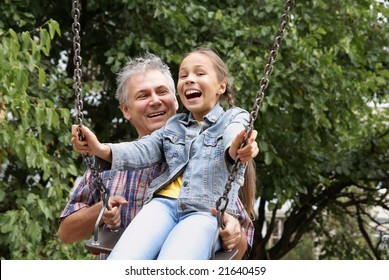 Cheerful father and daughter having fun on playground outdoors