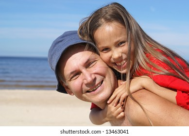 Cheerful father and daughter on a beach