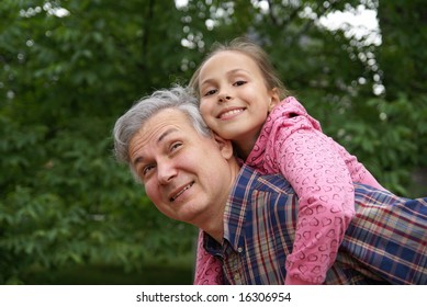 Cheerful father and daughter outdoors