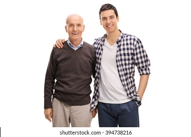 Cheerful father and son hugging and posing together isolated on white background