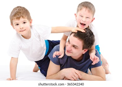Cheerful father and sons isolated on a white background
