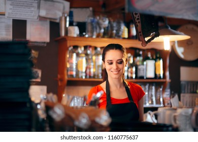 Cheerful Female Bartender Working Behind the Counter. Busy barmaid preparing drinks in a club