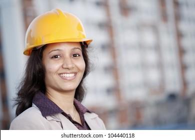 Cheerful female construction engineer