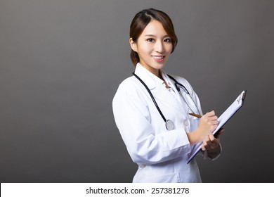 cheerful female doctor with clipboard