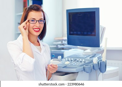 cheerful female doctor with ultrasound sensor