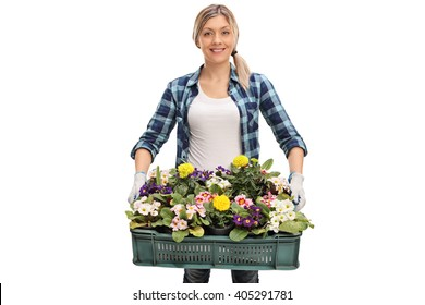 Cheerful female florist holding a rack of flowers and looking at the camera isolated on white background