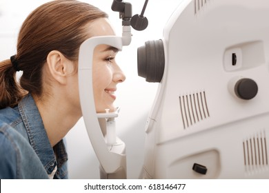 Cheerful female patient having her vision checked