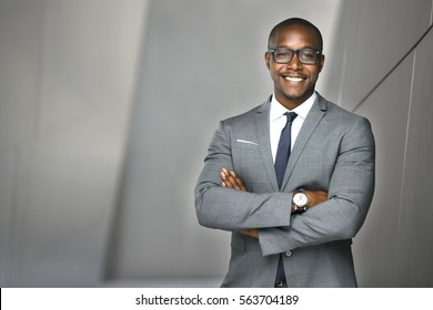 Cheerful financial executive business man stock investor standing tall and proud